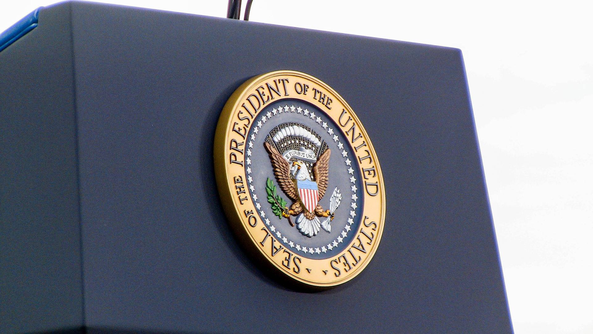 press release podium and presidential seal