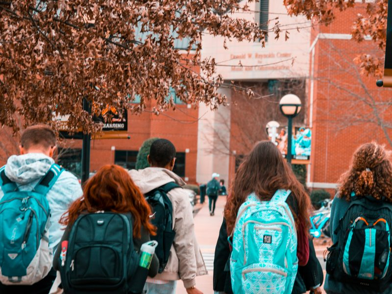 college students wearing backpacks