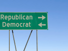 road sign pointing left and right to political parties